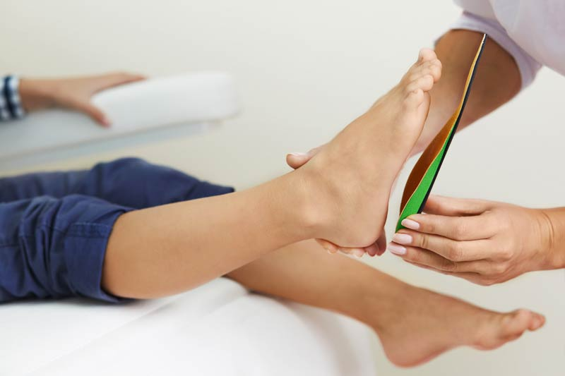 Insole fitting after biomechanical assessment from a Podiatrist